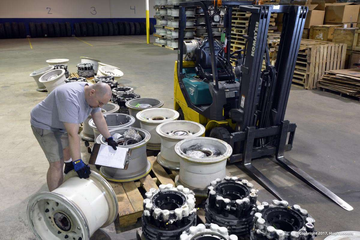 Employee arranges aircraft wheels inside of our warehouse