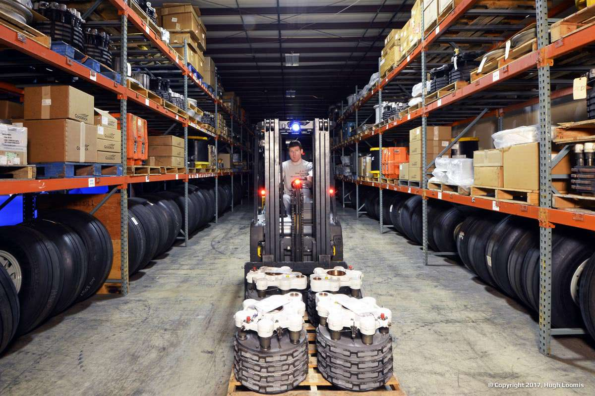 Forklift carrying aircraft brake assemblies