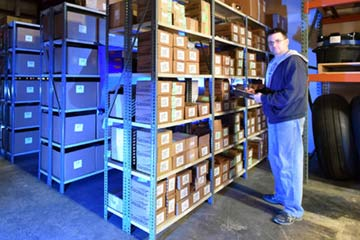 An employee taking aircraft parts inventory