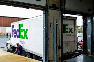 A FedEx truck in the loading dock receiving shipments of aircraft wheels and brakes