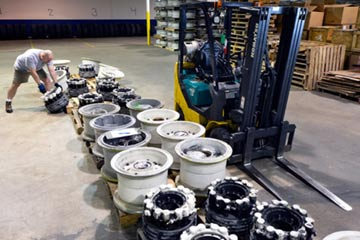 A lineup of aircraft wheels in the warehouse