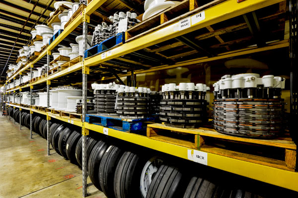 wheels and tires line the warehouse shelves